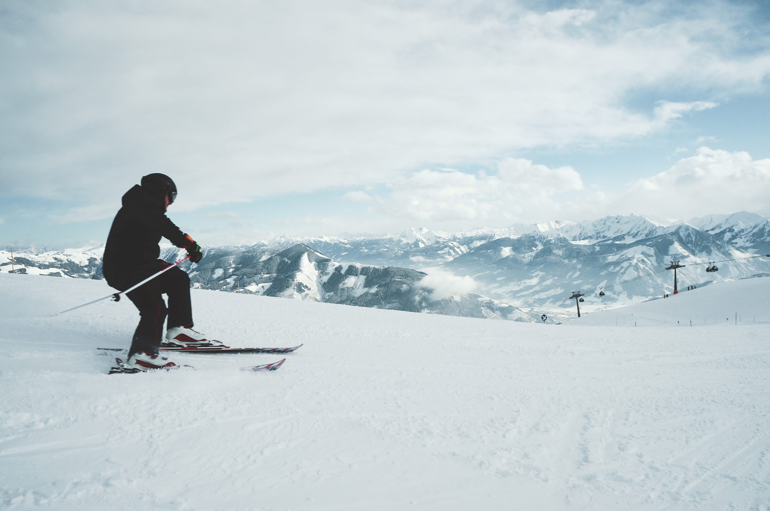 Beautiful shot of a man skiing on the mountains covered with white